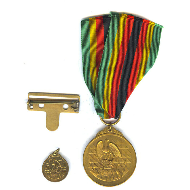 Independence Medal 1980 officialy numbered with original broach pin bar and miniature 1