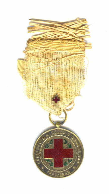 Red Cross merit medal 1909-1939 silver gilt and enamel with frayed ribbbon... 1
